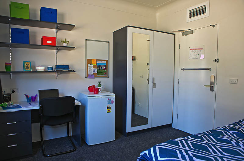 Typical room showing study area and wardrobe storage