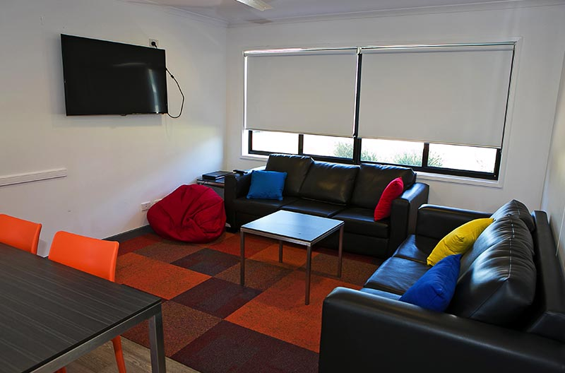 Lounge facilities with couch and tv