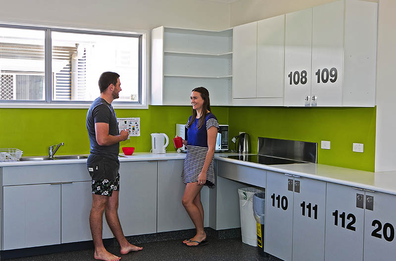 Students chatting in the kitchen area