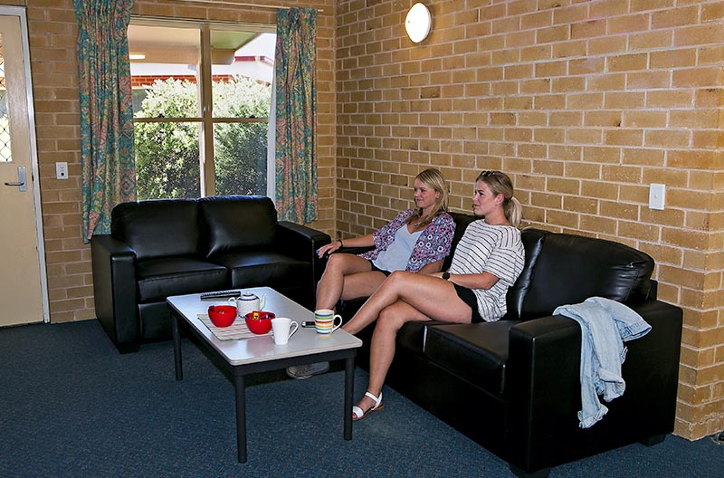 Students in the lounge area of a cottage