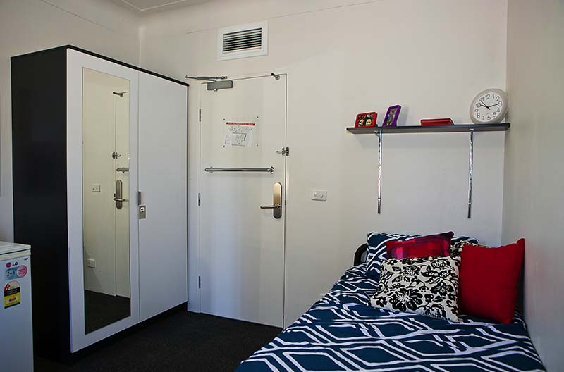 A view showing sleeping area and wardrobe spaces