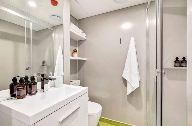 View of ensuite bathroom including shower and vanity unit