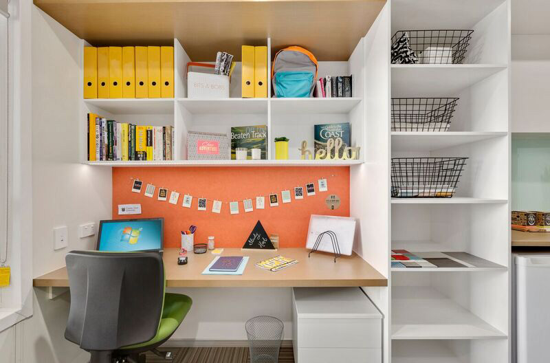 View of study space, including desk and storage