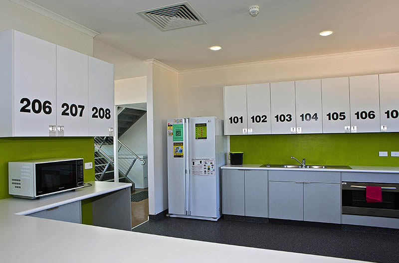 Kitchen area showing numbered cupboards